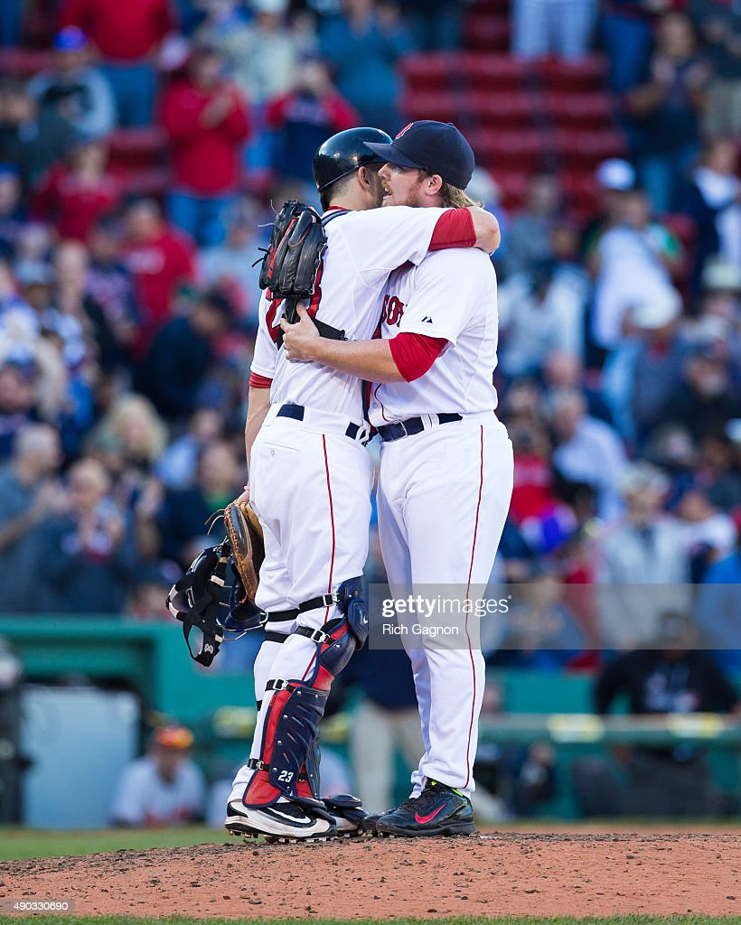 Robbie Ross Jr. #28 of the Boston Red Sox celebrates a 2-0 victory with teammate Blake Swihart #23 after pitching during the ninth inning against the Baltimore Orioles at Fenway Park on September 27, 2015 in Boston, Massachusetts.