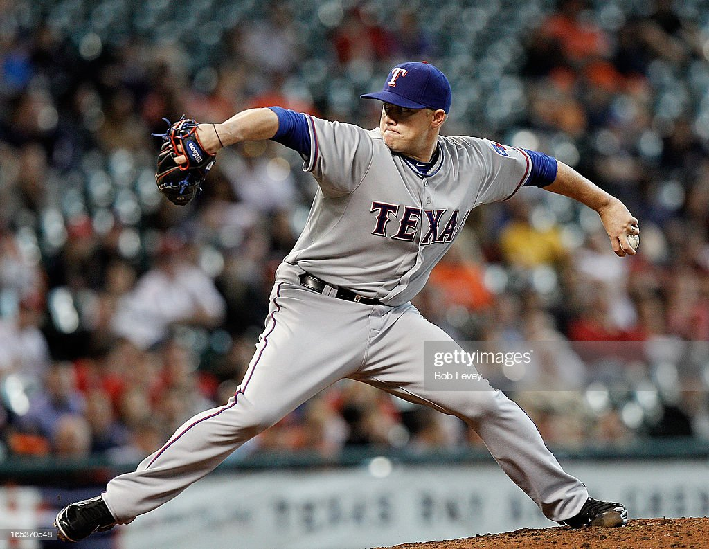 Robbie Ross #46 of the Texas Rangers pitches in the seventh inning against the Houston Astros at Minute Maid Park on April 3, 2013 in Houston, Texas.