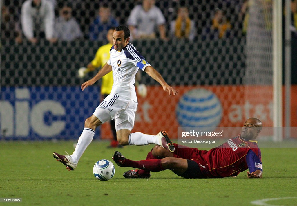 Robbie Russell #3 of Real Salt Lake slides in for the tackle on Landon Donovan #10 of the Los Angeles Galaxy in the second half of their MLS match at the Home Depot Center on April 17, 2010 in Carson, California. The Galaxy defeated Real Salt Lake 2-1.