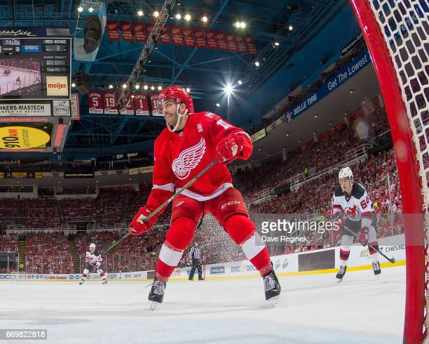 Robbie Russo of the Detroit Red Wings and Joseph Blandisi of the New Jersey Devils follows the play during the final home game ever played at Joe...