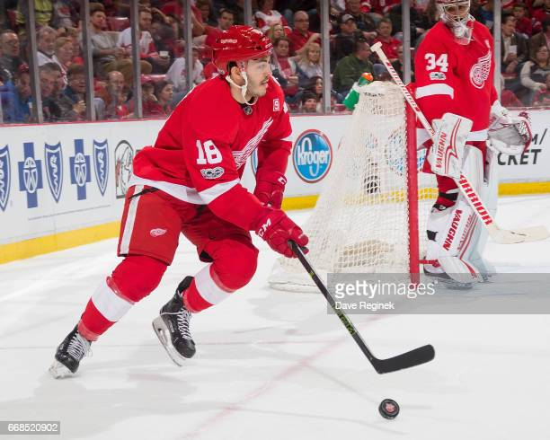 Robbie Russo of the Detroit Red Wings controls the puck against the Montreal Canadiens during an NHL game at Joe Louis Arena on April 8 2017 in...