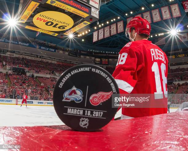 Robbie Russo of the Detroit Red Wings skates to bench in the background of the game puck featuring the Detroit Red Wings and the Colorado Avalanche...