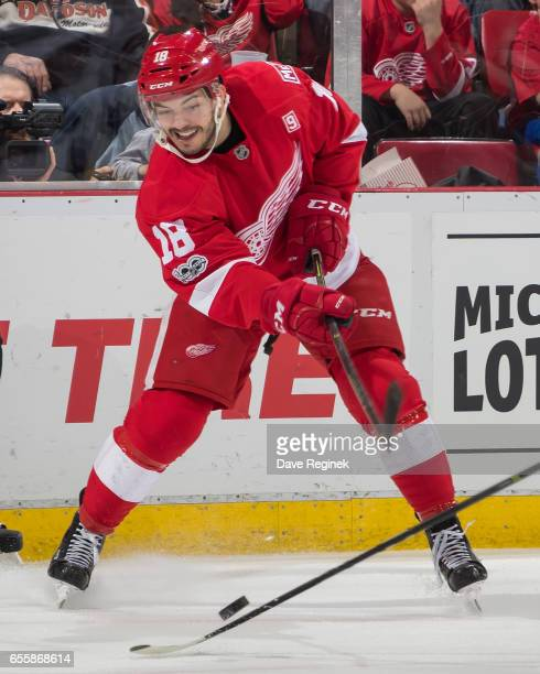 Robbie Russo of the Detroit Red Wings tries to clear the puck against the Colorado Avalanche during an NHL game at Joe Louis Arena on March 18 2017...