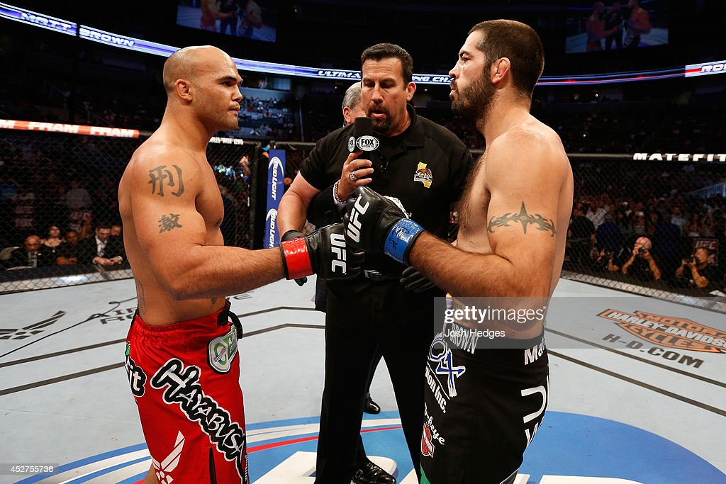 Robbie 'Ruthless' Lawler and Matt 'The Immortal' Brown touch gloves before facing each other in their welterweight bout during the UFC Fight Night event at SAP Center on July 26, 2014 in San Jose, California.