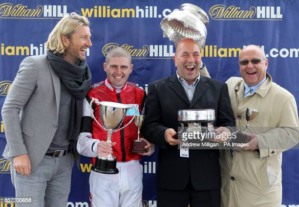 Robbie Savage after handing out the Kilkerran Cup to jockey Tony Hamilton owner Ronnie Devlin and trainer Richard Fahey after their horse Hi There...