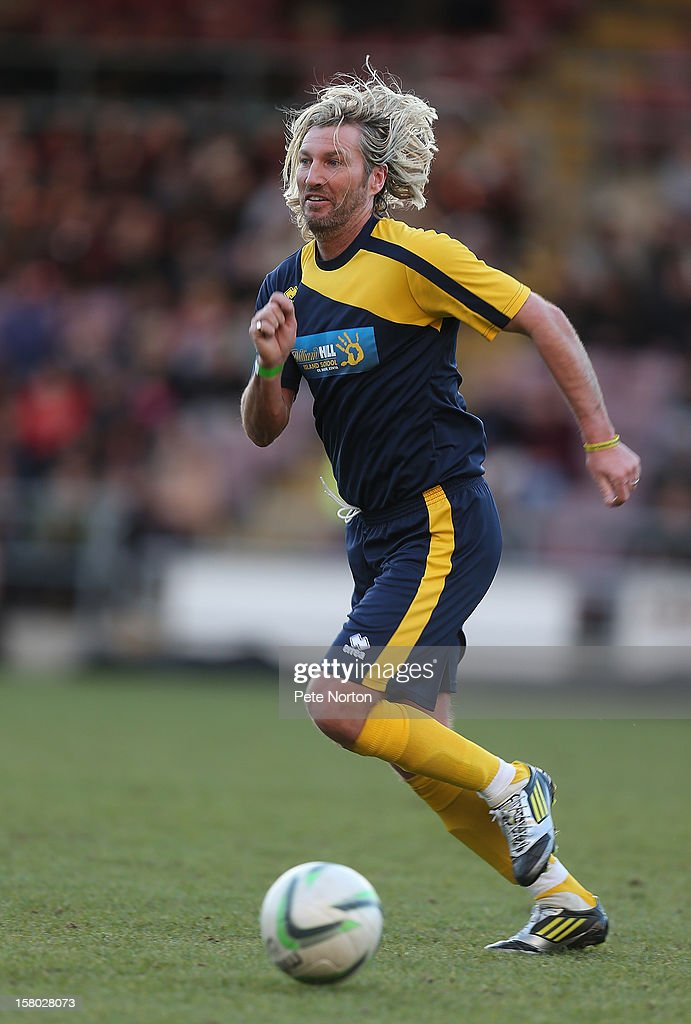 <a gi-track='captionPersonalityLinkClicked' href=/galleries/search?phrase=Robbie+Savage&family=editorial&specificpeople=169889 ng-click='$event.stopPropagation()'>Robbie Savage</a> in action during the William Hill Foundation Cup Celebrity Charity Challenge Match at Sixfields on December 9, 2012 in Northampton, England.