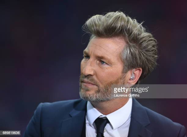 Robbie Savage of BT Sport looks on during the Emirates FA Cup Final between Arsenal and Chelsea at Wembley Stadium on May 27 2017 in London England