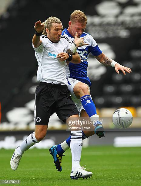 Robbie Savage of Derby and Garry O'Connor of Birmingham challenge for the ball during the PreSeason Friendly match between Derby County and...
