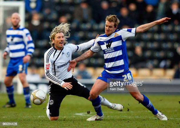 Robbie Savage of Derby County and James Coppinger of Doncaster Rovers battle for the ball during the FA Cup 4th Round match between Derby County and...