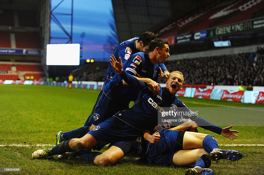 Robbie Simpson and <a gi-track='captionPersonalityLinkClicked' href=/galleries/search?phrase=Jose+Baxter&family=editorial&specificpeople=5015103 ng-click='$event.stopPropagation()'>Jose Baxter</a> of Oldham Athletic celebrate the third goal during the FA Cup with Budweiser Third Round match Nottingham Forest and Oldham Athletic at City Ground on January 5, 2013 in Nottingham, England.
