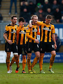 Robbie Simpson of Cambridge is congratulated by team mates after scoring to make it 10 during the FA Cup Third Round match between Cambridge United...