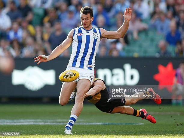 Robbie Tarrant of the Kangaroos and Brandon Ellis of the Tigers in action during the 2015 AFL First Elimination Final match between the Richmond...