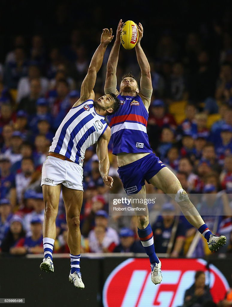 Robbie Tarrant of the Kangaroos and Jordan Roughead of the Bulldogs compete for the ball during the round six AFL match between the North Melbourne Kangaroos and the Western Bulldogs at Etihad Stadium on April 29, 2016 in Melbourne, Australia.