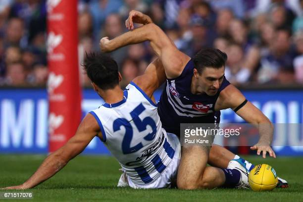 Robbie Tarrant of the Kangaroos and Shane Kersten of the Dockers contest for the ball during the round five AFL match between the Fremantle Dockers...