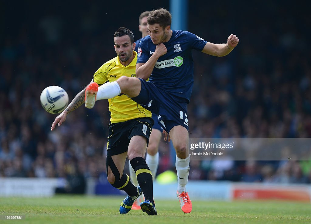 Robbie Weir of Burton Albion battles with Will Atkinson of Southend United during the Sky Bet League Two semi-final, second leg match between Southend United and Burton Albion at Roots Hall on May 17, 2014 in Southend, England.