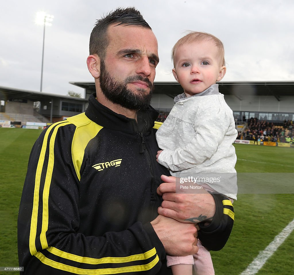 Robbie Weir of Burton Albion celebrates with his daughter on a lap of honour at the end of the Sky Bet League Two match between Burton Albion and Northampton Town at Pirelli Stadium on April 25, 2015 in Burton-upon-Trent, England.