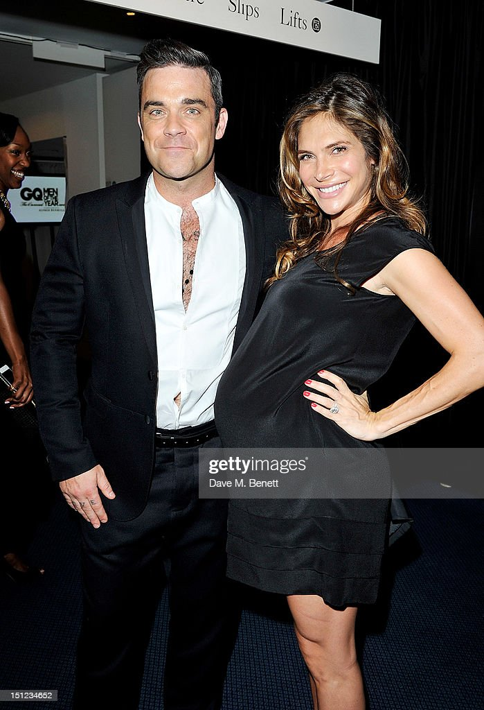 Robbie Williams (L) and Ayda Field arrive at the GQ Men Of The Year Awards 2012 at The Royal Opera House on September 4, 2012 in London, England.
