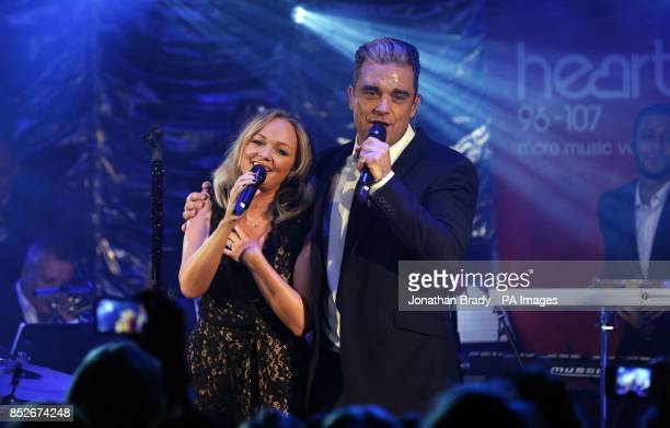 Robbie Williams and Emma Bunton perform a duet during an exclusive gig for Heart radio at Under the Bridge in London
