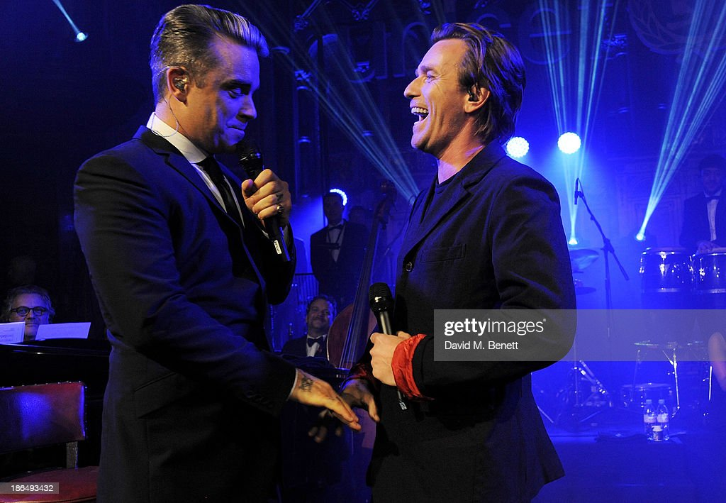 <a gi-track='captionPersonalityLinkClicked' href=/galleries/search?phrase=Robbie+Williams&family=editorial&specificpeople=201201 ng-click='$event.stopPropagation()'>Robbie Williams</a> (L) and <a gi-track='captionPersonalityLinkClicked' href=/galleries/search?phrase=Ewan+McGregor&family=editorial&specificpeople=202863 ng-click='$event.stopPropagation()'>Ewan McGregor</a> perform 'Angels' together at the UNICEF UK Halloween Ball hosted by Jemima Khan, raising vital funds for UNICEF's work for children affected by the current Syria crisis, at One Mayfair on October 31, 2013 in London, England. All money raised for Unicef from today - and for the next three months - will be matched pound for pound by the UK Government to help the children of Syria. Text 'Syria' to 70007 to give £5 to help UNICEF reach even more children caught up in the crisis.