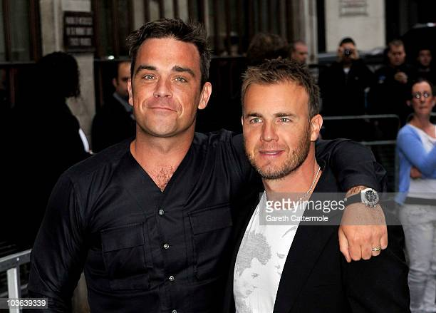 Robbie Williams and Gary Barlow arrive at the Radio 1 studios for an interview with Chris Moyles on August 26 2010 in London England