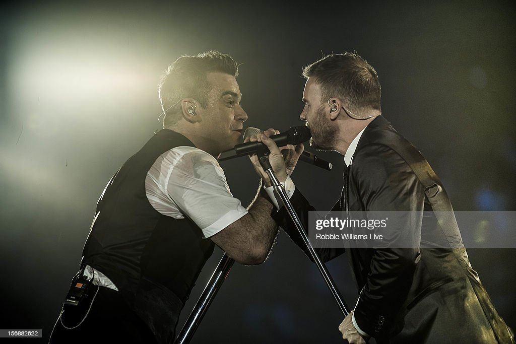 Image has been desaturated.) <a gi-track='captionPersonalityLinkClicked' href=/galleries/search?phrase=Robbie+Williams&family=editorial&specificpeople=201201 ng-click='$event.stopPropagation()'>Robbie Williams</a> and <a gi-track='captionPersonalityLinkClicked' href=/galleries/search?phrase=Gary+Barlow&family=editorial&specificpeople=616384 ng-click='$event.stopPropagation()'>Gary Barlow</a> perform on the second night of <a gi-track='captionPersonalityLinkClicked' href=/galleries/search?phrase=Robbie+Williams&family=editorial&specificpeople=201201 ng-click='$event.stopPropagation()'>Robbie Williams</a> tour at 02 Arena on November 23, 2012 in London, England.