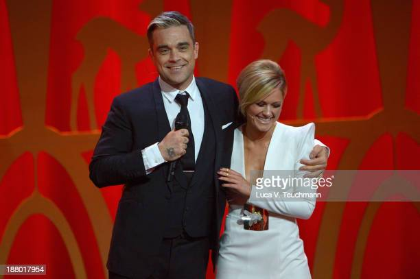 Robbie Williams and Helene Fischer talk on stage at the Bambi Awards 2013 at Stage Theater on November 14 2013 in Berlin Germany