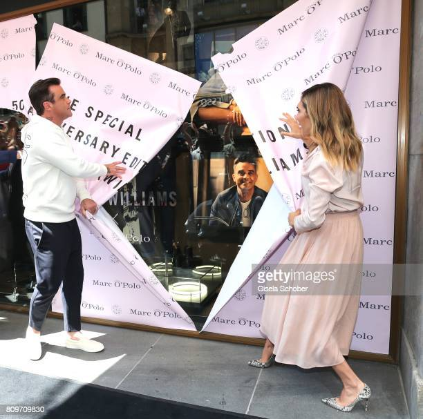 Robbie Williams and his wife Ayda Williams during the launch of the Marc O'Polo 50th anniversary special edition sweatshirt on July 6 2017 in Munich...