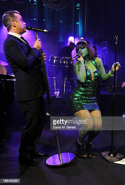 Robbie Williams and Lily Allen duet at the UNICEF UK Halloween Ball hosted by Jemima Khan raising vital funds for UNICEF's work for children affected...