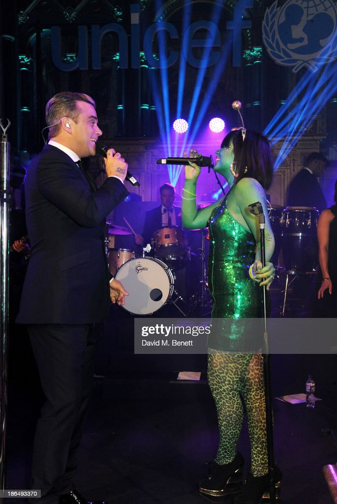 <a gi-track='captionPersonalityLinkClicked' href=/galleries/search?phrase=Robbie+Williams&family=editorial&specificpeople=201201 ng-click='$event.stopPropagation()'>Robbie Williams</a> (L) and <a gi-track='captionPersonalityLinkClicked' href=/galleries/search?phrase=Lily+Allen&family=editorial&specificpeople=724899 ng-click='$event.stopPropagation()'>Lily Allen</a> duet at the UNICEF UK Halloween Ball hosted by Jemima Khan, raising vital funds for UNICEF's work for children affected by the current Syria crisis, at One Mayfair on October 31, 2013 in London, England. All money raised for Unicef from today - and for the next three months - will be matched pound for pound by the UK Government to help the children of Syria. Text 'Syria' to 70007 to give £5 to help UNICEF reach even more children caught up in the crisis.