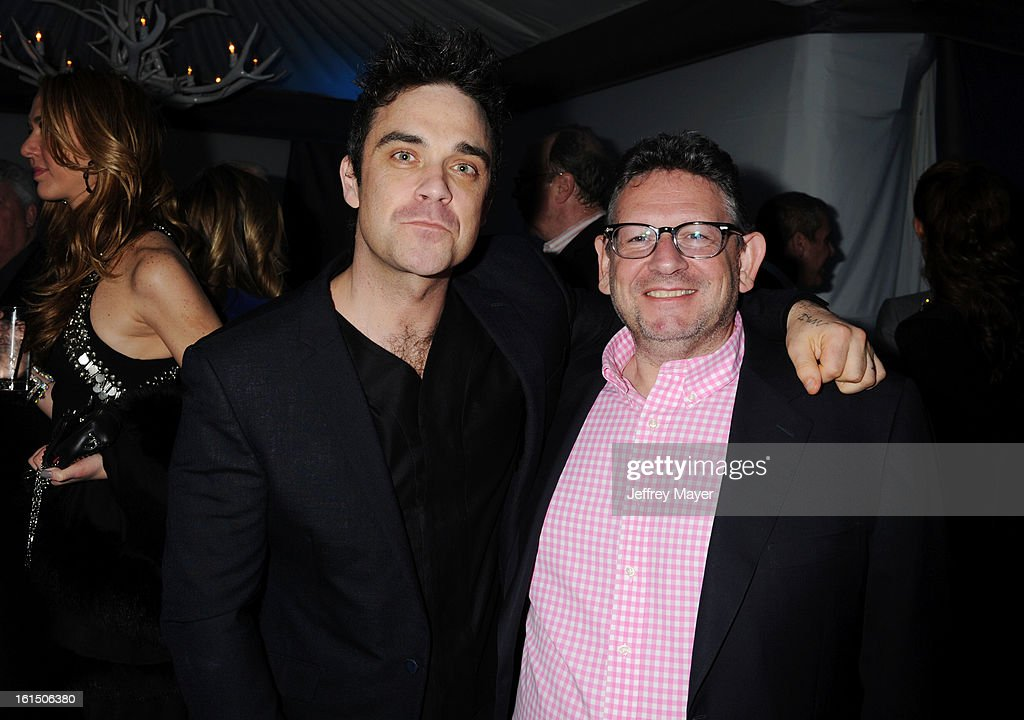 <a gi-track='captionPersonalityLinkClicked' href=/galleries/search?phrase=Robbie+Williams&family=editorial&specificpeople=201201 ng-click='$event.stopPropagation()'>Robbie Williams</a> and Lucian Grainge, Chairman & CEO of Universal Music Group attend the Universal Music Group Chairman & CEO Lucian Grainge's annual Grammy Awards viewing party on February 10, 2013 in Brentwood, California.