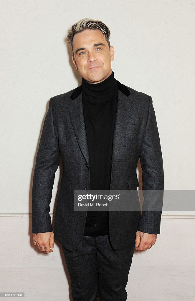 Robbie Williams arrives at The Q Awards at The Grosvenor House Hotel on October 21 2013 in London England