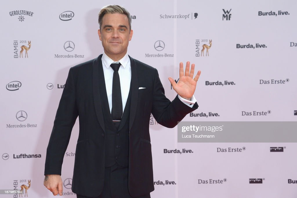 <a gi-track='captionPersonalityLinkClicked' href=/galleries/search?phrase=Robbie+Williams&family=editorial&specificpeople=201201 ng-click='$event.stopPropagation()'>Robbie Williams</a> attends the Bambi Awards 2013 at Stage Theater on November 14, 2013 in Berlin, Germany.