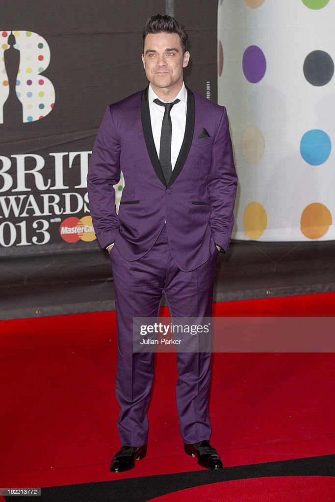 <a gi-track='captionPersonalityLinkClicked' href=/galleries/search?phrase=Robbie+Williams&family=editorial&specificpeople=201201 ng-click='$event.stopPropagation()'>Robbie Williams</a> attends the Brit Awards 2013 at the 02 Arena on February 20, 2013 in London, England.