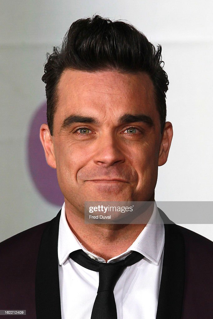 Robbie Williams attends the Brit Awards at 02 Arena on February 20, 2013 in London, England.