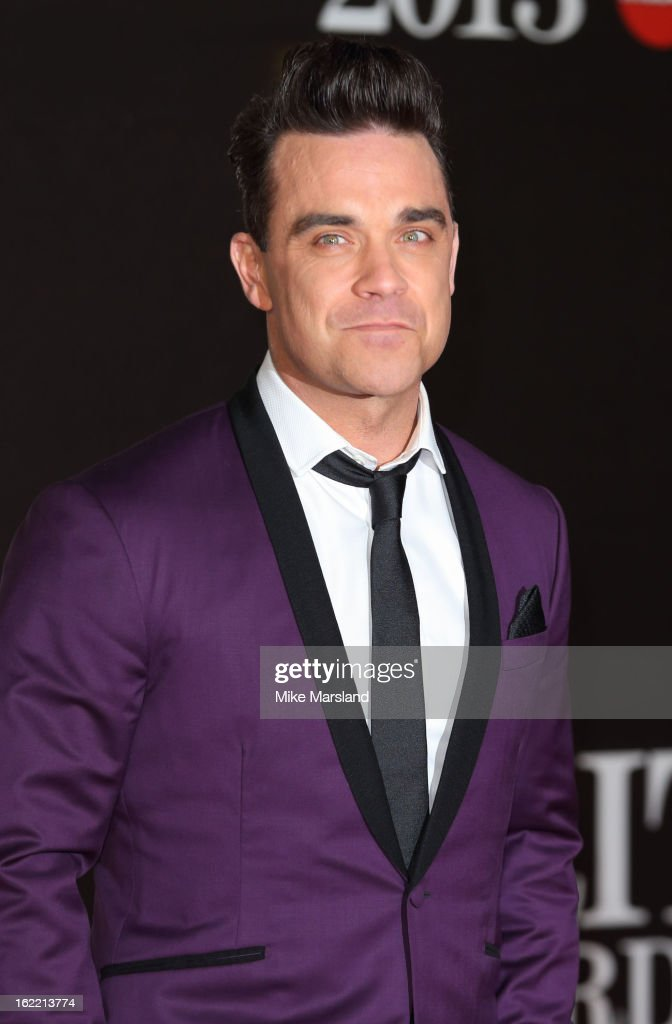 <a gi-track='captionPersonalityLinkClicked' href=/galleries/search?phrase=Robbie+Williams&family=editorial&specificpeople=201201 ng-click='$event.stopPropagation()'>Robbie Williams</a> attends the Brit Awards at 02 Arena on February 20, 2013 in London, England.