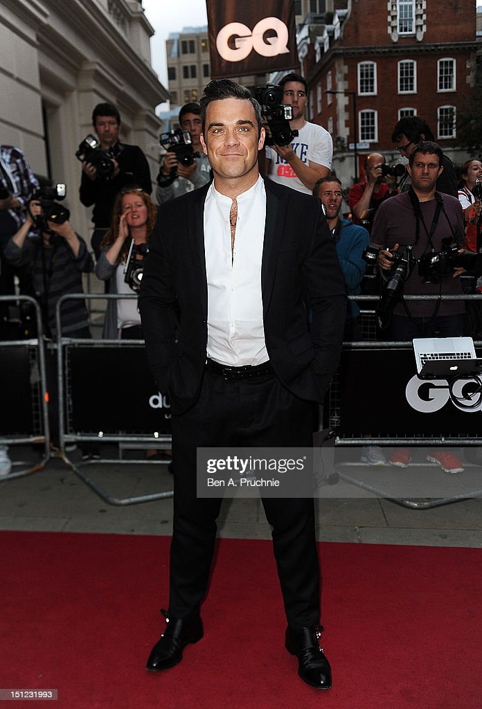 Robbie Williams attends the GQ Men of the Year Awards 2012 at The Royal Opera House on September 4, 2012 in London, England.