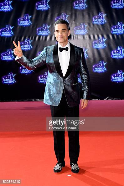 Robbie Williams attends the18th NRJ Music Awards Red Carpet Arrivals at Palais des Festivals on November 12 2016 in Cannes France