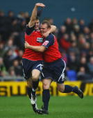 Robbie Williams celebrates his goal with Anthony Pilkiington during the CocaCola League One match between Oldham Athletic and Huddersfield Town at...