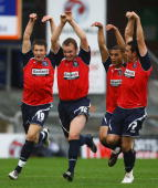 Robbie Williams celebrates his goal with team mates during the CocaCola League One match between Oldham Athletic and Huddersfield Town at Boundary...