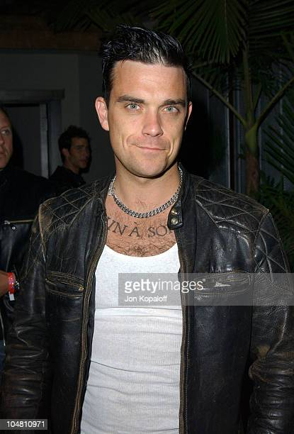 Robbie Williams during Nylon Magazine Lil' Kim Celebrate The Magazine's Summer Music Issue at White Lotus in Hollywood California United States
