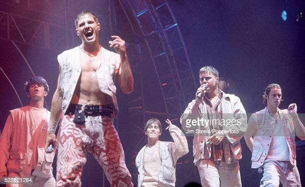Robbie Williams Jason Orange Mark Owen Gary Barlow and Howard Donald of Take That performing on stage at the Wembley Arena in London circa July 1993
