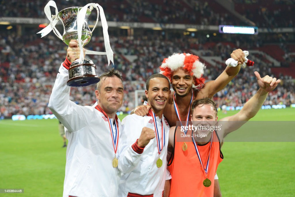 <a gi-track='captionPersonalityLinkClicked' href=/galleries/search?phrase=Robbie+Williams&family=editorial&specificpeople=201201 ng-click='$event.stopPropagation()'>Robbie Williams</a>, <a gi-track='captionPersonalityLinkClicked' href=/galleries/search?phrase=Marvin+Humes&family=editorial&specificpeople=2887070 ng-click='$event.stopPropagation()'>Marvin Humes</a>, <a gi-track='captionPersonalityLinkClicked' href=/galleries/search?phrase=Aston+Merrygold&family=editorial&specificpeople=5739699 ng-click='$event.stopPropagation()'>Aston Merrygold</a> and <a gi-track='captionPersonalityLinkClicked' href=/galleries/search?phrase=Olly+Murs&family=editorial&specificpeople=6350751 ng-click='$event.stopPropagation()'>Olly Murs</a> attend Soccer Aid 2012 in aid of Unicef at Old Trafford on May 27, 2012 in Manchester, England.