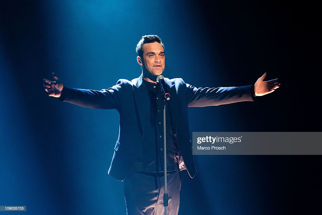 Robbie Williams of Take That performs during the 193th 'Wetten Dass' show at the Messe Halle on February 12 2011 in Halle Germany