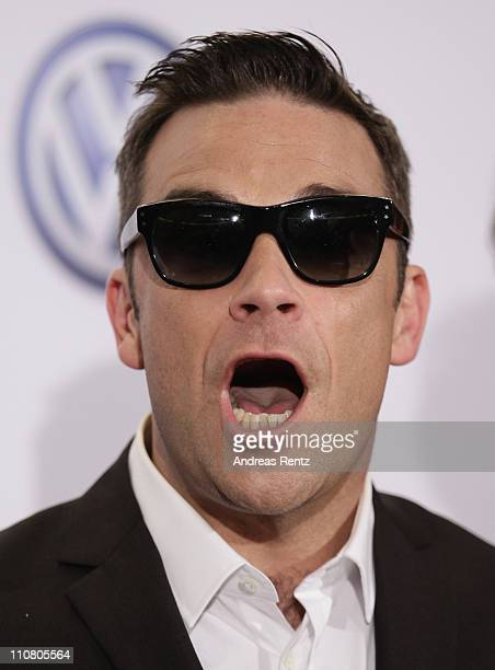Robbie Williams of Take That poses with his award during the Echo award 2011 at Palais am Funkturm on March 24 2011 in Berlin Germany