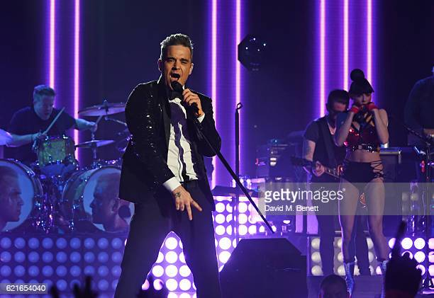 Robbie Williams performs at a special gig presented by Cafe Royal to award him the BRITs Icon Award at the Troxy on November 7 2016 in London England