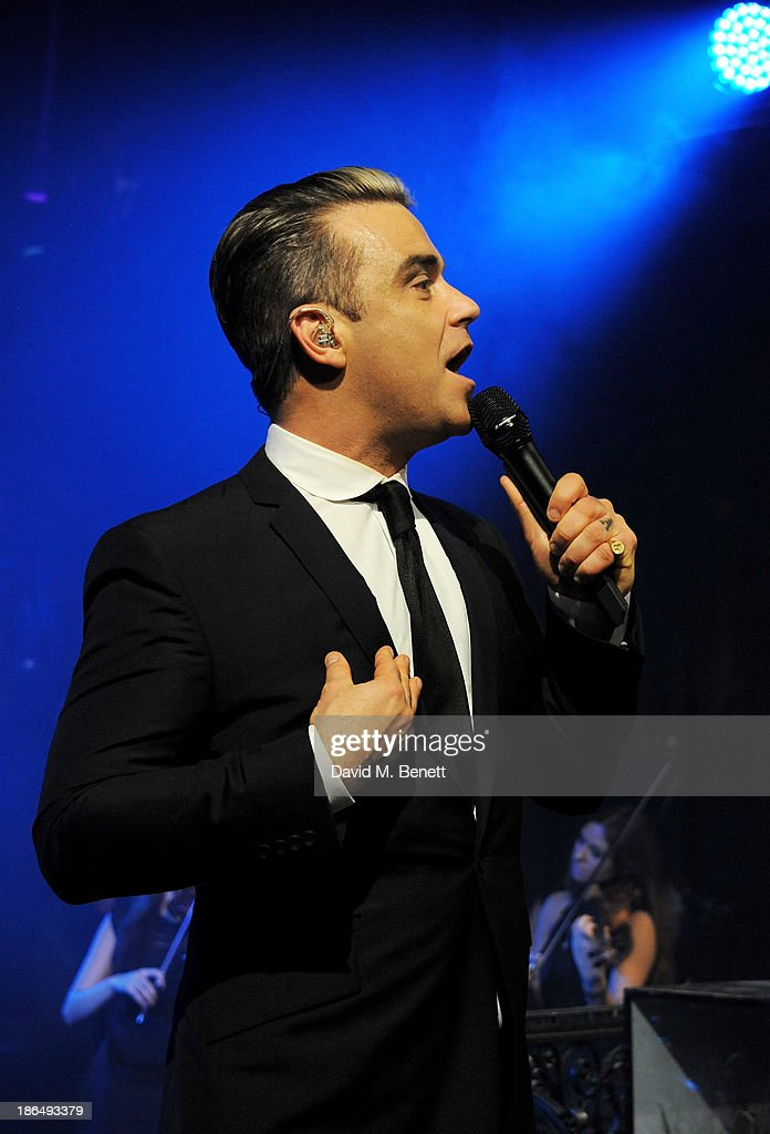 <a gi-track='captionPersonalityLinkClicked' href=/galleries/search?phrase=Robbie+Williams&family=editorial&specificpeople=201201 ng-click='$event.stopPropagation()'>Robbie Williams</a> performs at the UNICEF UK Halloween Ball hosted by Jemima Khan, raising vital funds for UNICEF's work for children affected by the current Syria crisis, at One Mayfair on October 31, 2013 in London, England. All money raised for Unicef from today - and for the next three months - will be matched pound for pound by the UK Government to help the children of Syria. Text 'Syria' to 70007 to give £5 to help UNICEF reach even more children caught up in the crisis.