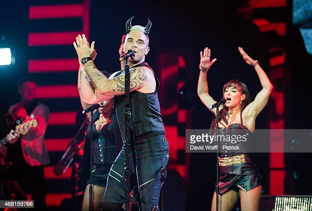 Robbie Williams performs at Zenith de Paris on March 30 2015 in Paris France