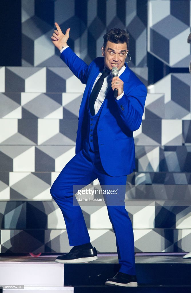 Robbie Williams performs live on stage during the Brit Awards 2013 at 02 Arena on February 20 2013 in London England