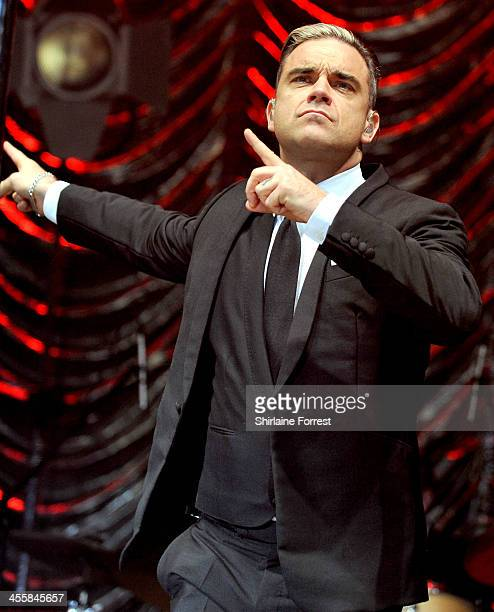 Robbie Williams performs on stage at Key 103 Jingle Ball 2013 at Phones 4u Arena on December 12 2013 in Manchester United Kingdom