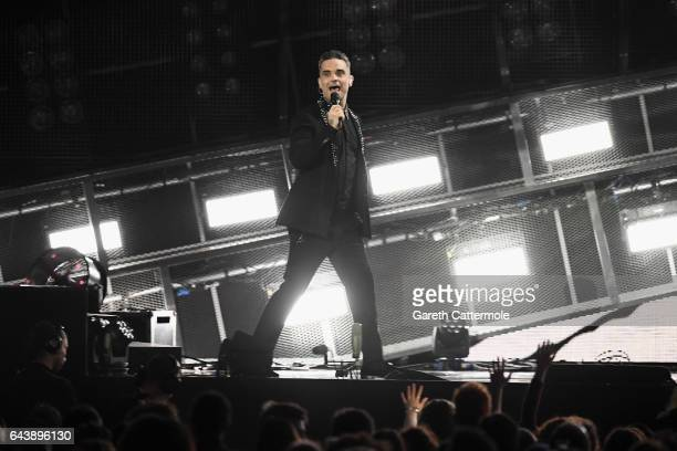 Robbie Williams performs on stage at The BRIT Awards 2017 at The O2 Arena on February 22 2017 in London England